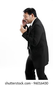 Superstitious - Asian business man with crossed fingers over white background