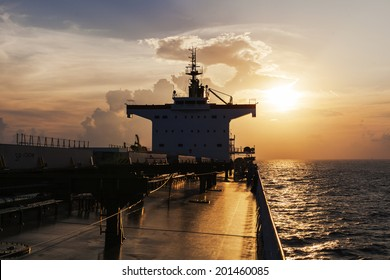 Superstructure of the cargo ship at sunset