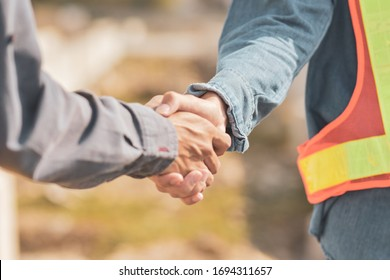Supervisor building teamwork partnership gesture and people concept handshake on construction site