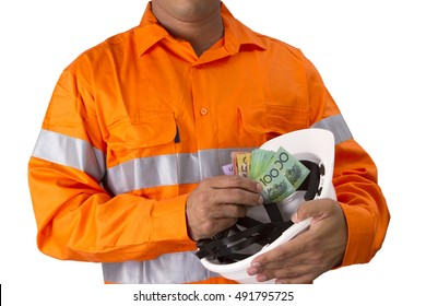 Supervisor with construction hard hat and high visibility shirt  holding and counting Australian dollars on a white background. Trade job worker or out door employees earning money for job.