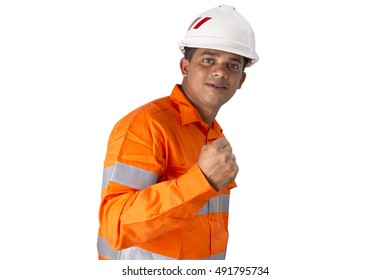 Supervisor with construction hard hat and high visibility shirt showing success with fist or hand on a white background. Men with reflective high visibility orange work wear shirt.