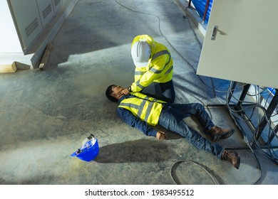 Supervisor first aid help injured worker accident electric shock unconscious. Asian electrician worker accident electric shock unconscious in site work.