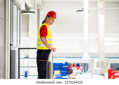 Supervisor monitoring work in a factory