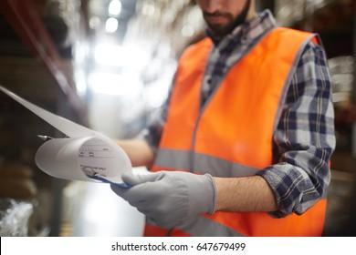 Supervisor reading document at work
