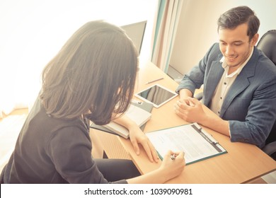 Supervisor is smiling between job interviewing a female worker