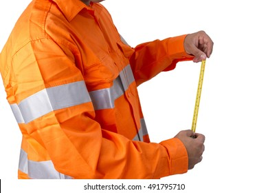Supervisor with tape measure wearing high visibility shirt on a white background. Men with reflective high visibility orange work wear shirt for highly visible in work environment.