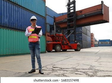 supervisor is working in container yard with forklift