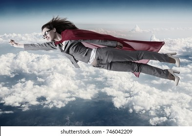 Superwoman flying above the skies