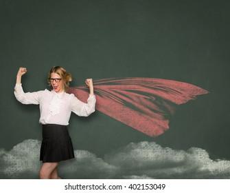 Superwoman nerd geek teacher student in blackboard drawing cape successful confident transformation space