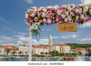 SUPETAR, CROATIA – JULY 19, 2021: Picturesque old town of Supetar. Supetar is the biggest town of Brac island in Croatia.
