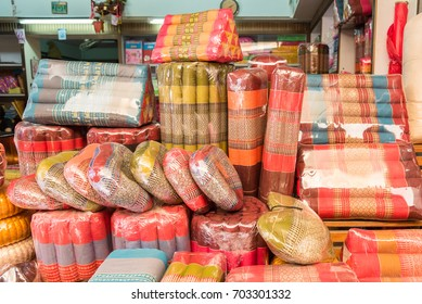 Suphan Buri, Thailand - August, 20, 2017 : Shop of thai triangular backrest pillow in Samchuk Market at Suphan Buri, Thailand