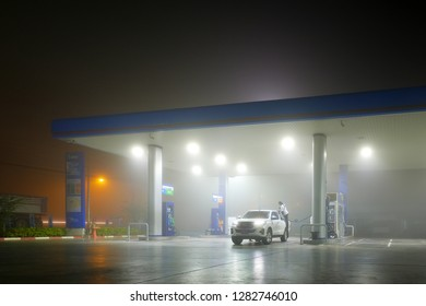 SUPHAN BURI, THAILAND - FEBRUARY 2, 2018: PTT gas station in early morning with bad vision from foggy.