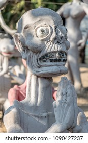 SUPHAN BURI, THAILAND, JAN 01 2018, The ghost of sinner with his hands clasped. A scene from Buddhist hell. Torture of sinful people, afterlife.