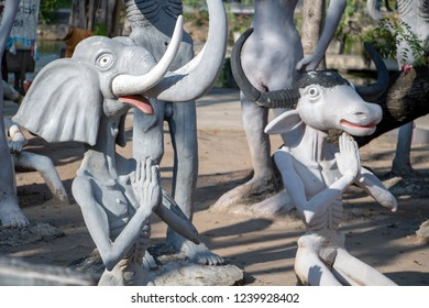SUPHAN BURI, THAILAND, JAN 01 2018, The ghost of sinner as praying animals with his hands clasped. A scene from Buddhist hell.