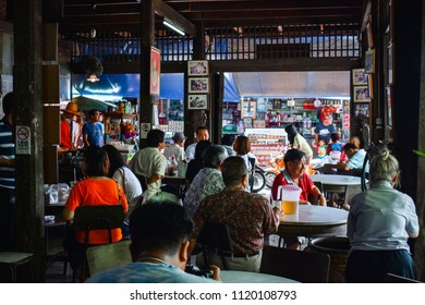 SUPHAN BURI, THAILAND - JUNE 24 2018 : Many people meeting in Old style Thai Coffee Shop and restaurant