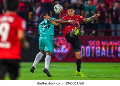 Suphanan Bureerat  (red)of SCG Muangthong United in action during The Football Thai League between SCG Muangthong United and PT Prachuap F.C.at SCG Stadium on February24,2019 in Nonthaburi,Thailand