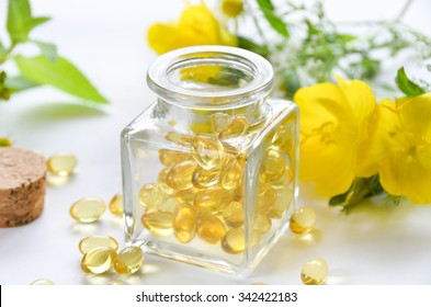 supplement in a bottle with evening primrose flowers