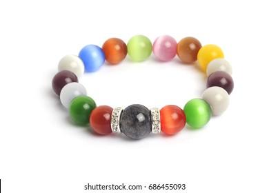 supplement a good fortune ?? Black Rutilliated Quartz colorful Cat's eye quartz stone bracelet amulet with white isolated background