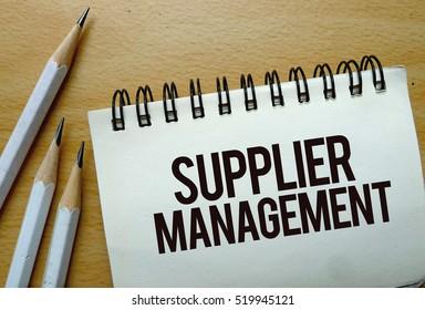 Supplier Management text written on a notebook with pencils