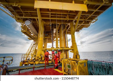 Supply boat or crew boat transfer cargo to oil and gas industry and moving cargo from the boat to the platform, boat waiting transfer cargo and passenger between oil and gas platform