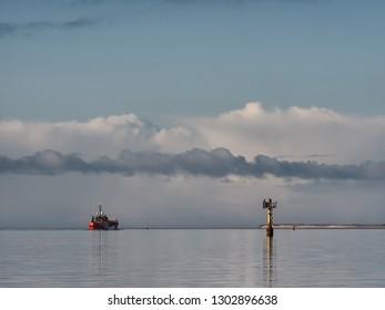 Supply ship leavng Esbjerg offshore harbor, Denmark