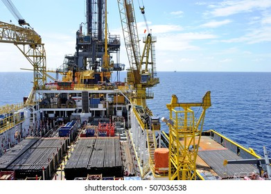 A supply vessel docking at an oil rig