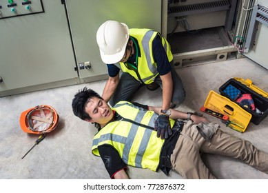 Support allows patient, Life-saving and rescue methods. Accident at work of electrician job or Maintenance worker in the control room of factory.
