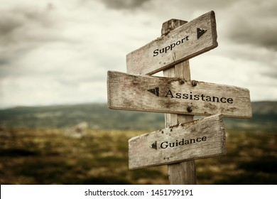 Support, assistance and guidance signpost outdoors in nature. Moody feeling. Need help, call for help, helping, stuck, road concept.
