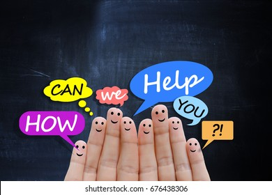 """Support or call center concept with happy human fingers on dark background asking """"how can I help you?"""""""