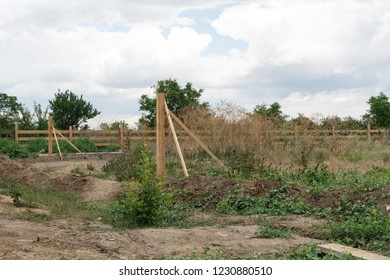 Support fence. Construction of a wooden rural fence.