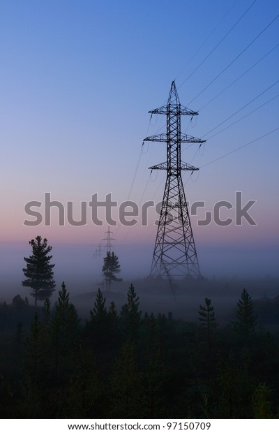 Support of a line of electricity transmission in the foggy morning