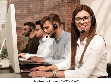 support technician in the headset is pointing at you