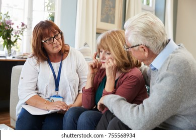 Support Worker Visits Senior Woman Suffering With Depression