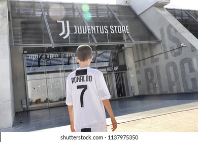 Supporter of Juventus fc wearing Cristiano Ronaldo jersey outside the official store Turin Italy July 19 2018