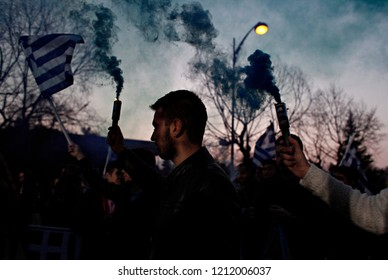 Supporters of New Democracy party hold a Greek flag during a campaign rally by their leader Greek Prime Minister Antonis Samaras in Thessaloniki, Greece on Jan. 21, 2015 .