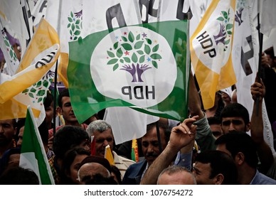Supporters of the pro-Kurdish Peoples' Democratic Party (HDP) wave party flags as they attend in election rally  in Istanbul, Turkey on May 30, 2015