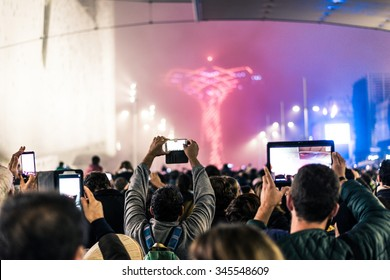 Supporters recording at concert - Candid image of crowd at rock concert - Several people taking photos at an event
