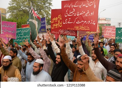 Supporters of the religious political party, chant slogans during a protest following the Supreme Court decision on Pakistani Christian woman Asia Bibi, in Lahore on November 02, 2018.