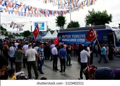 Supporters of Turkish President Tayyip Erdogan hold up AK (AKP) party flag in front of Turkey's ruling AK Party (AKP) headquarters in Istanbul,Turkey, June 24, 2018.