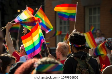 Supporters wave rainbow flags and signs at the annual Pride Parade as it passes through Greenwich Village in New York City