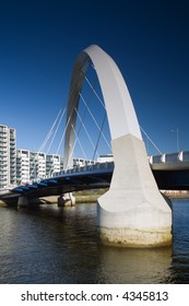 The supporting arch of the Clyde Arc bridge in Glasgow, Scotland, against a blue sky