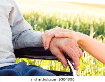 Supporting hand for grandfather with Alzheimer's disease.