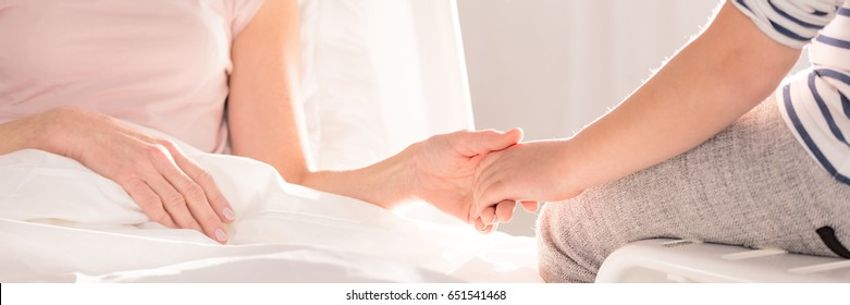 Supportive hold of women's hands