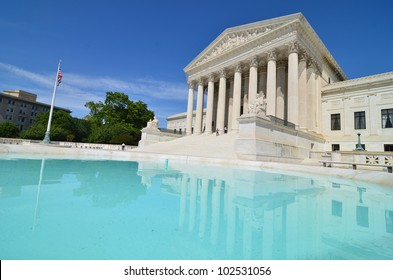 Supreme Court Building with mirror reflection on the pool