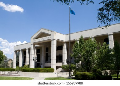 Supreme Court of Nevada building located in Carson City, NV against a blue sky.