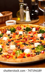 Supreme pizza with broccoli and feta cheese