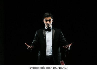 Suprised Magician,magician with playing cards,Juggler man,Mystery person,Black magic,illusion