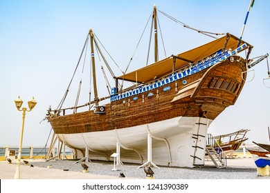 Sur, Oman - August 16, 2018: Fateh Alkhair Ship at Al Qanjah Boat Yard in Sur, Oman.