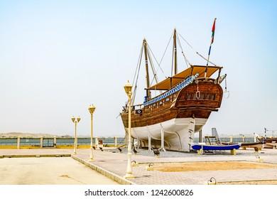 Sur, Oman - August 16, 2018: Fateh Alkhair Ship at Al Qanjah Boat Yard in Sur, Oman.
