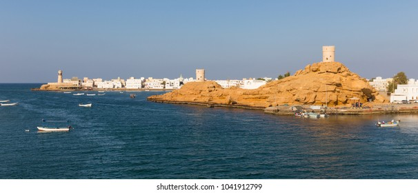 SUR, OMAN - NOVEMBER 25, 2017: View of the Al Ayjah town, two watchtowers and the lighthouse in Sur, Oman